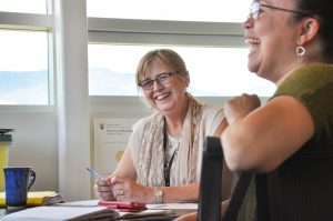 Margaret Macintyre Latta, project director, consults with educators from School District 23